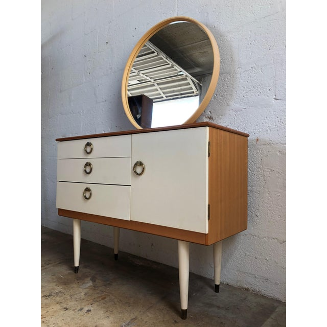 Vintage 1970s Mid Century Modern Dresser/ Vanity with a removable round mirror By Schreiber England. Perfect for a small...
