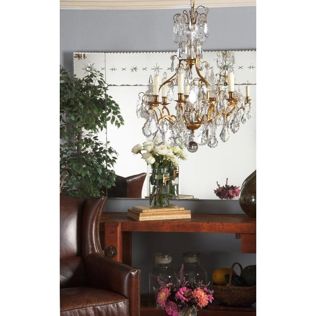 A Napoleon III birdcage nine-light chandelier with a gilded bronze structure that was purchased in the Loire Region of...