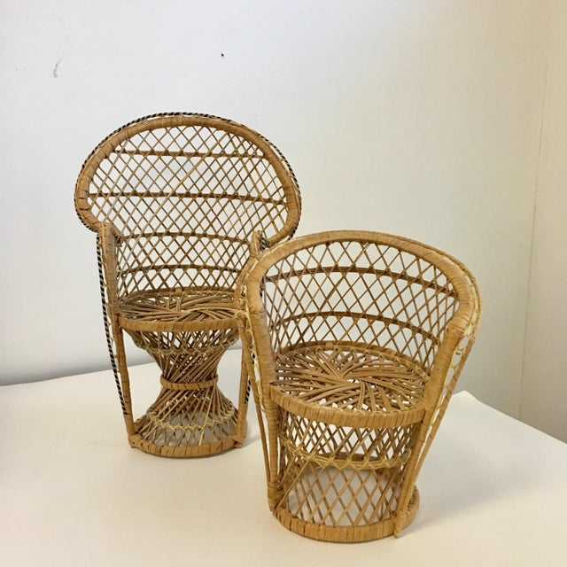 A darling pair of petite vintage wicker chairs that can be used as plant stands. These are scaled down versions of the...