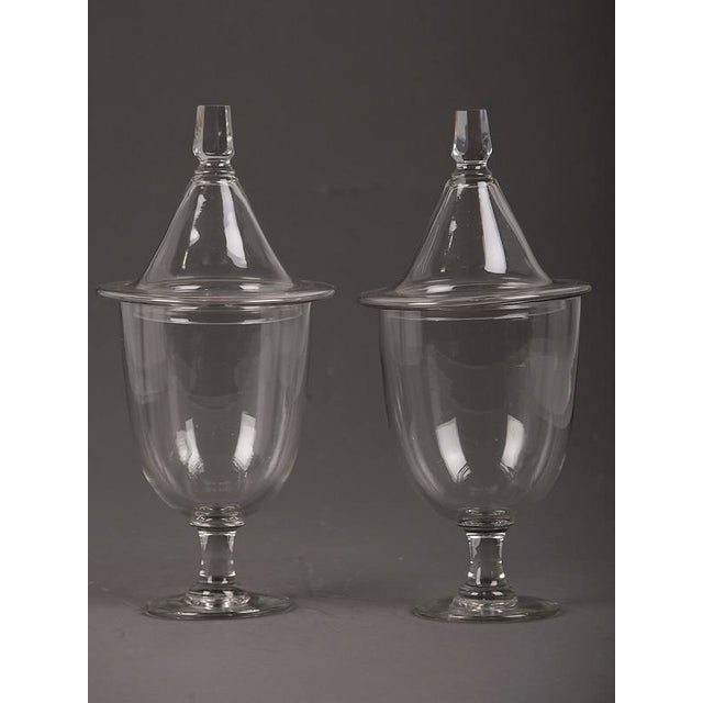 A pair of Regency style glass urns each with a lid, England c. 1880.