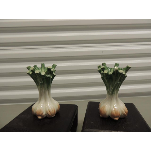 Pair of hand painted green and white ceramic onions candle holders. Hand painted ceramic onion candle holders. From Fitz &...