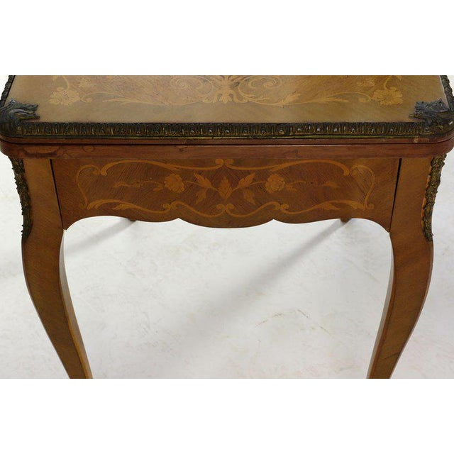 Beautiful French Louis XV style kingwood and marquetry inlaid flip top game table having gilt bronze mounts. Hinged top...