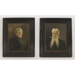 Pair of ebonized framed oil painting portraits of lady with hair up and man with long beard