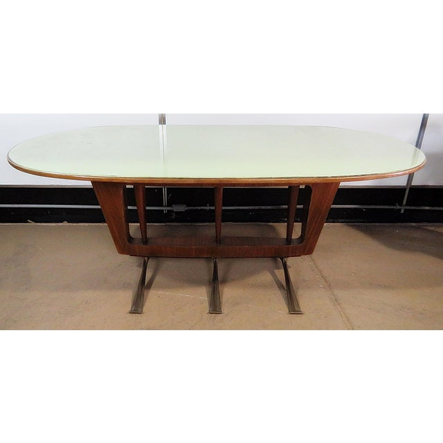 Italian modern walnut dining table with a glass top and brass legs.