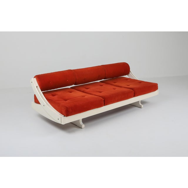 Daybed and Sofa model GS195 made by Gianni Songia for Sormani. White lacquered base with red velvet upholstery. The...
