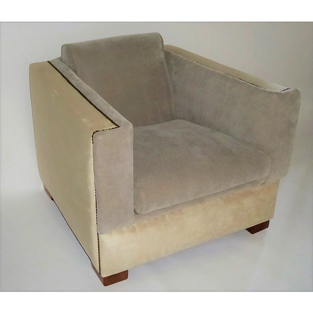 REDUCED FROM $3000.... This early 1940s deco lounge chair has a great footprint and presence. Upholstered in cream and...