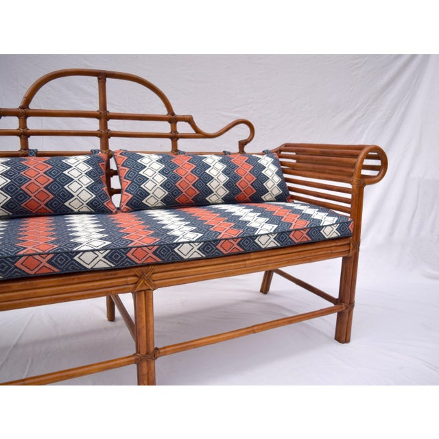 Bent bamboo scroll arm chinoiserie sofa by Lane. Leather joinery throughout and substantial caned seat enhanced with new...