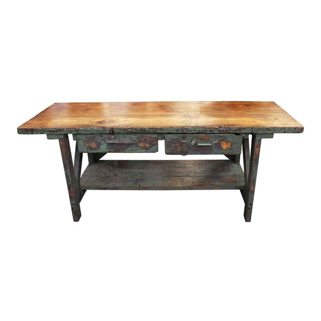 Green painted oak primitive style work table with two large drawers with unmatched hardware, a natural stained wood top...