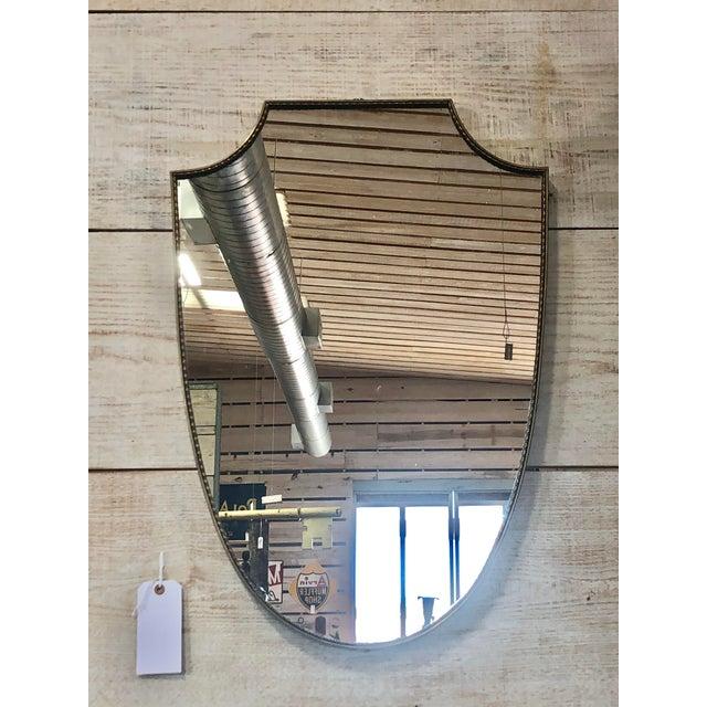 Midcentury Italian Gio Ponti shield brass mirror.