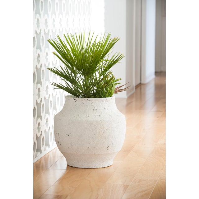 This low, round ceramic pot features a textured white washed finish and a slight, curved design. Perfect for showcasing...