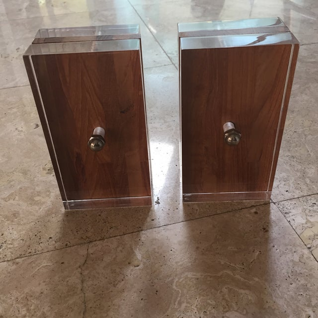 Mid-century-modern original pair of lucite and wood bookends designed by Herb Ritts, the son of the renowned photographer...