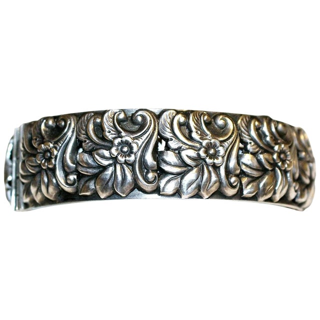 1950s Sterling Silver Floral Repoussé Hinged Bangle For Sale