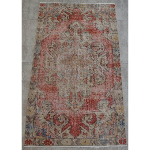 Vintage 1950's distressed Turkish Oushak Area rug. Distressed aesthetic and character bring out the charm and texture in...
