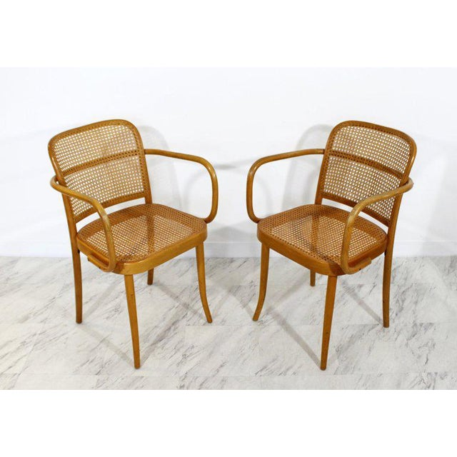 For your consideration is a wonderful pair of cane and bentwood armchairs, by Josef Hoffman for Stendig. In very good...