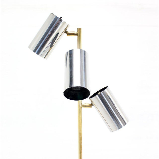 Mid-century modern triple fully adjustable shades floor lamp.