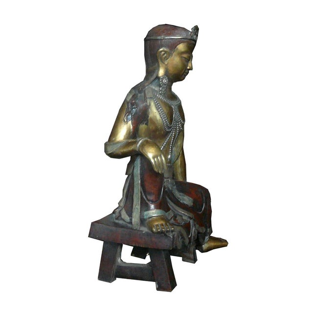 This is a traditional Chinese Tibetan style Tar statue made from metal and gilded with brownish, light metal and golden...