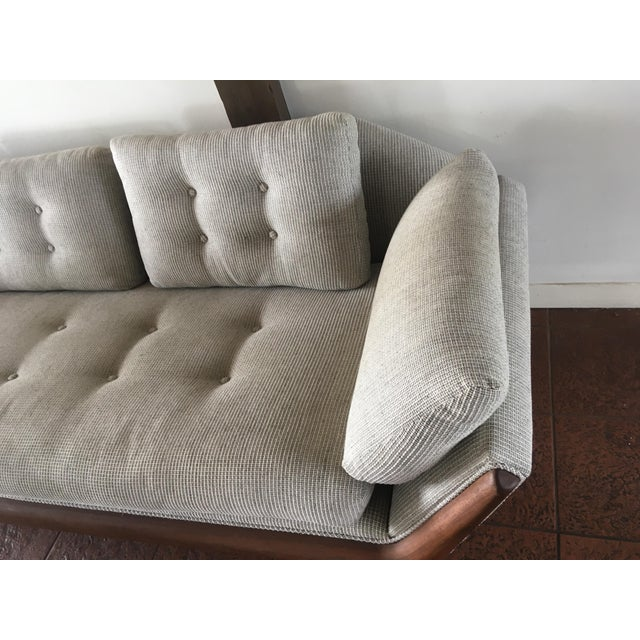 This beautiful vintage modern sofa features the innovative design of Mid-Century great Adrian Pearsall. Sculpted walnut...