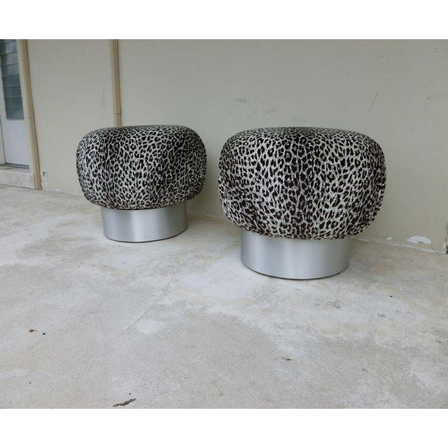 Pair 70's Karl Springer style leopard fabric souffle poufs fat aluminum bases measuring 24 inches in diameter and 18...