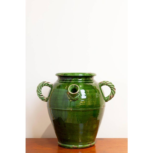 Large French Provençal storage jar, late 19th century. Beautiful deep green glaze with rope-twist handles and detail on...