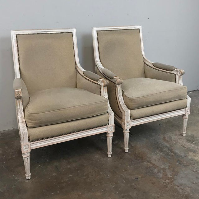Pair 19th Century French Louis XVI Bergeres ~ Armchairs are upholstered in a wonderful neutral fabric, and feature a...