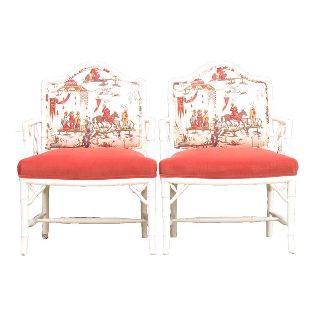 Pair of newly painted, newly upholstered, faux bamboo Chinoiserie armchairs with generous proportions. Upholstered with...