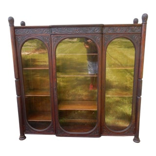 Antique 19th Century American Intricately Carved Anthacus Three Door Bookcase For Sale