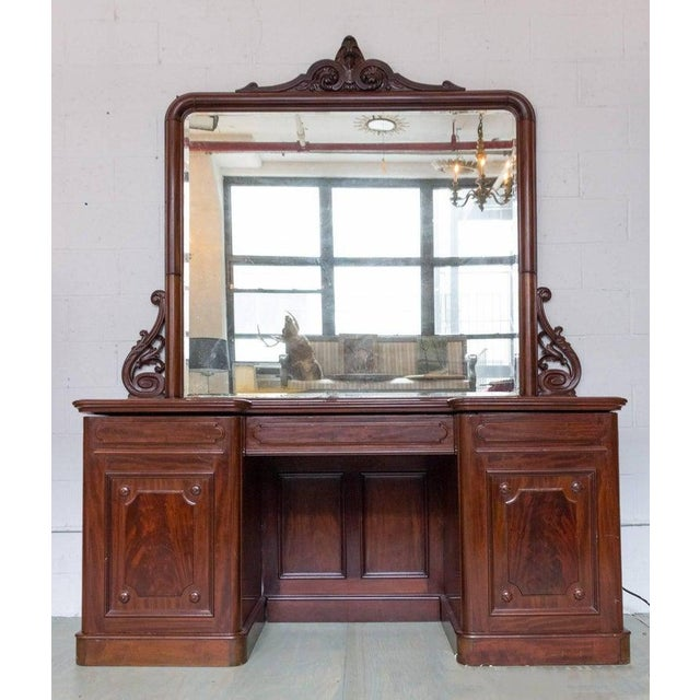 Beautiful large flame mahogany carved sideboard with oversized mercury mirror. The top is one solid piece of mahogany!...