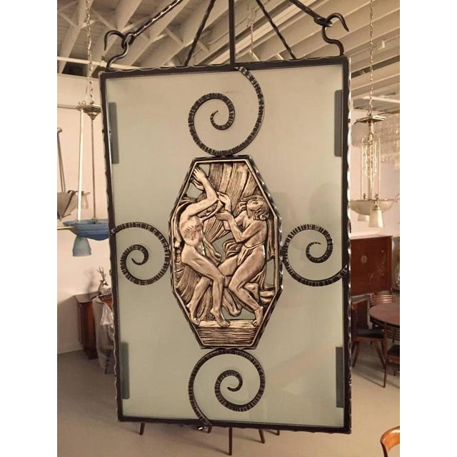 Stunning French Art Deco nickel over bronze and iron lantern. The frame having figural bronze panels depicting mythical...
