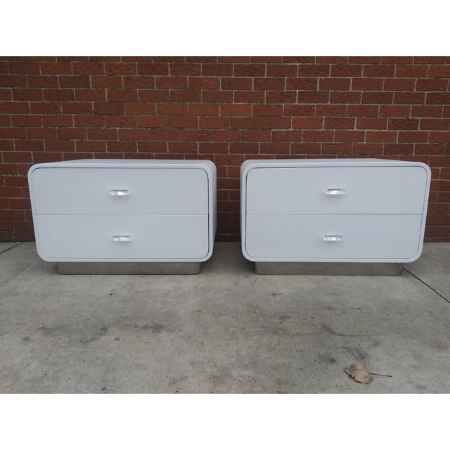 Up for grabs are these Unique 1970s - 1980s Space Age Looking Nightstands. They were refinished and sprayed in a semi-...