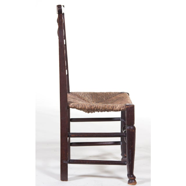 A wonderful hand carved and turned rush seated farm house chair made in England during the 19th century. Condition: Good