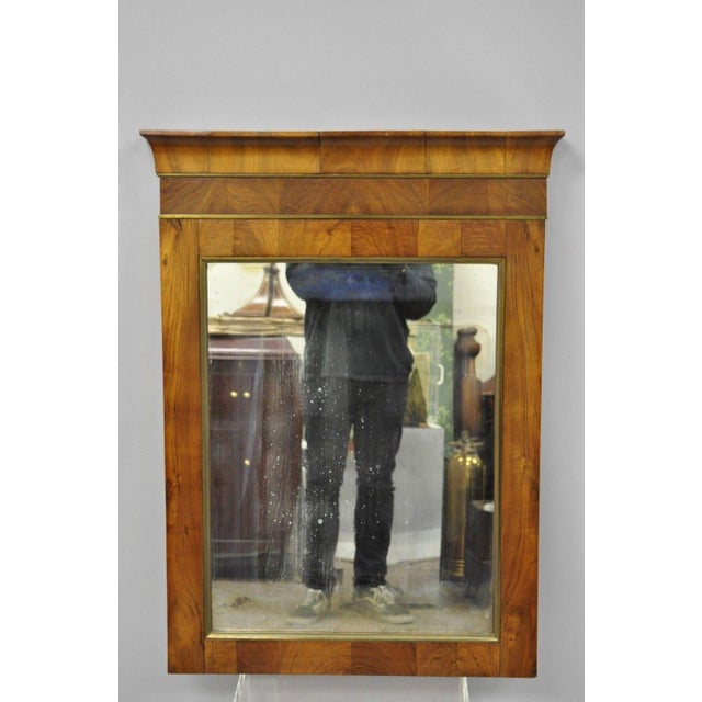 """Item features brass trim to crest and mirror border, stunning crotch mahogany wood grain, desirable """"looking glass""""..."""