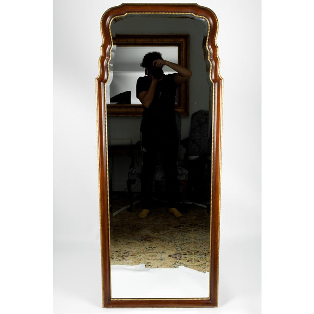 Vintage French style mahogany wood framed hanging wall mirror. The hanging mirror is in excellent vintage condition. The...