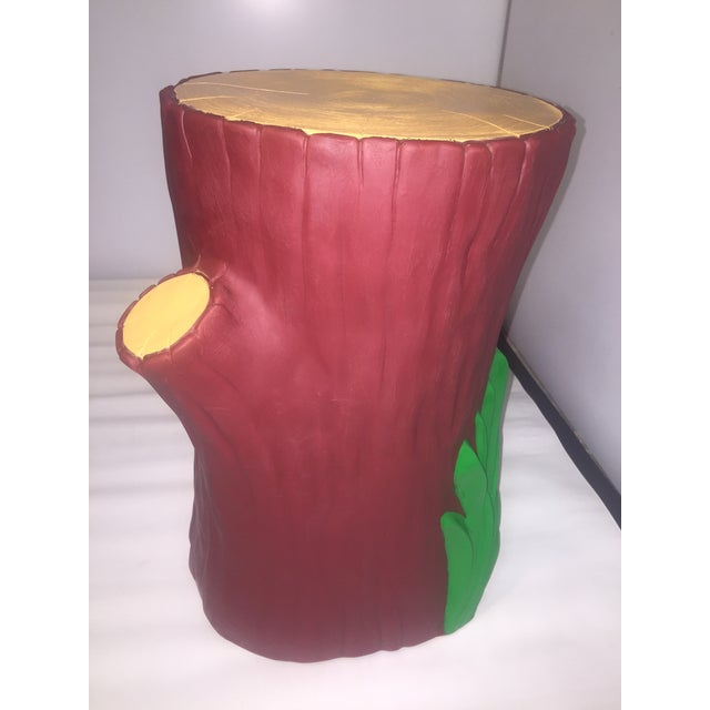 Philippe Starck designed this whimsical tree stump table-stool in 2000 for Kartell. It's made of batch-dyed thermoplastic...