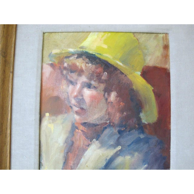Framed oil painting on canvas of young girl in yellow hat, signed at lower right, but I can't decipher. Wood frame...