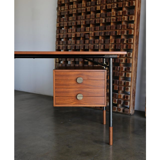 Finn Juhl desk for Bovirke, circa 1950. The teak wood has been professionally restored. Original patina to the hardware....