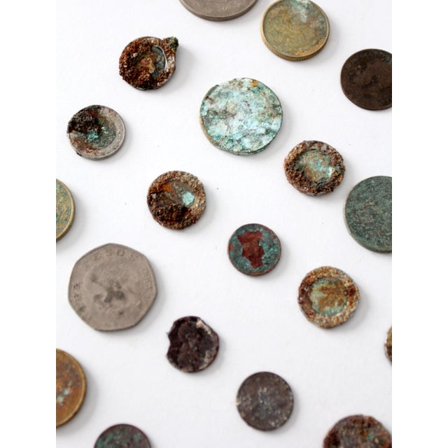 This is a collection of vintage oxidized coins. A remarkable display, each coin shows beautiful corrosion and patina in...
