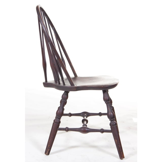 A handsome smaller scaled Windsor chair on turned legs with an nice older finish. Condition: Nice dry older finish. Wear...