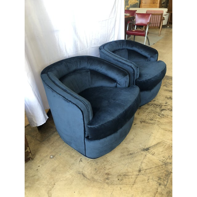 Handsome pair of Hollywood Regency and/or mid century style barrel chairs on casters for easy mobility. These chairs have...