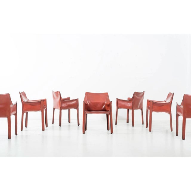 Bellina Cab Chairs in Cognac Leather; Cab was conceived in 1977, as an extension and prosthesis for the body: a skeleton...