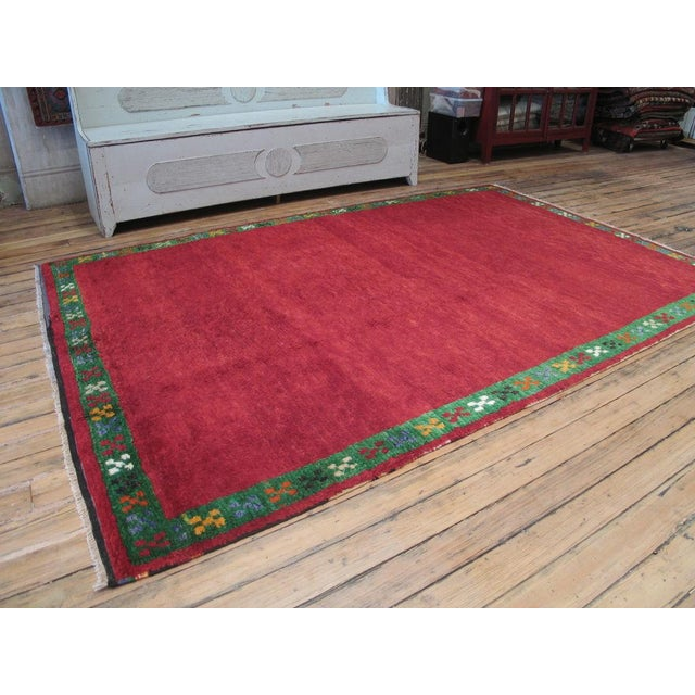 """Woven in the """"tulu"""" tradition, but not as shaggy. Very charming, cheeful and unique, a carpet that puts a smile on your face."""