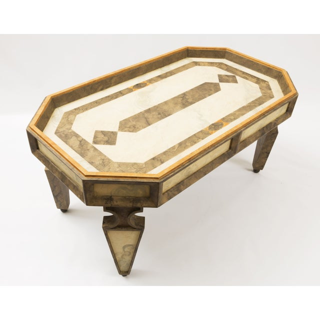 A custom made coffee table with beautiful faux painted marble. The faux marble features a tri-colored design in tan,...