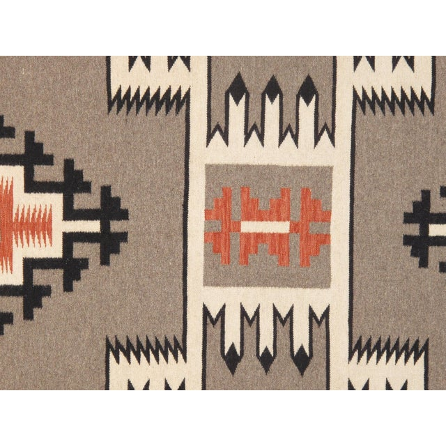 Here is an intriguing and decidedly modern navajo style carpet - a navajo style that was hand-woven of top quality wool in...
