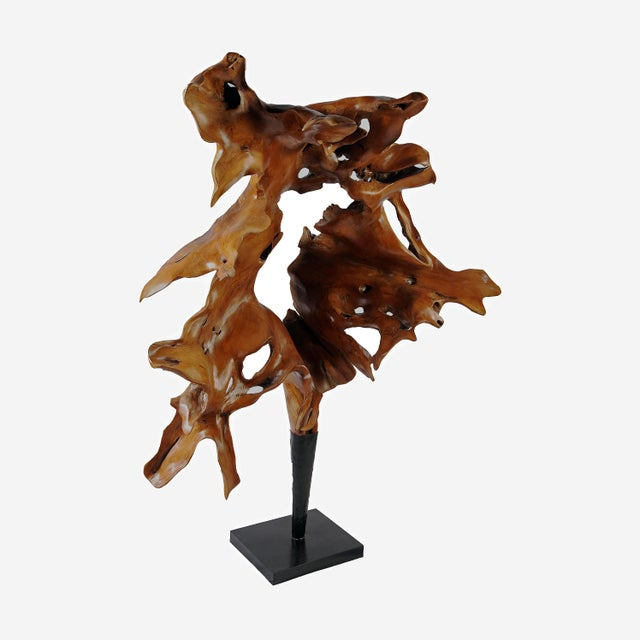 Inspired by the beauty of natural roots formation, this large organic teak sculpture is hand carved from one piece of...