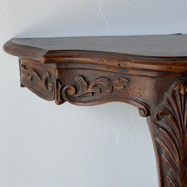 Vintage French wooden console with carved detail. Height: 21.5 in Width: 25 in Depth: 16.5 in