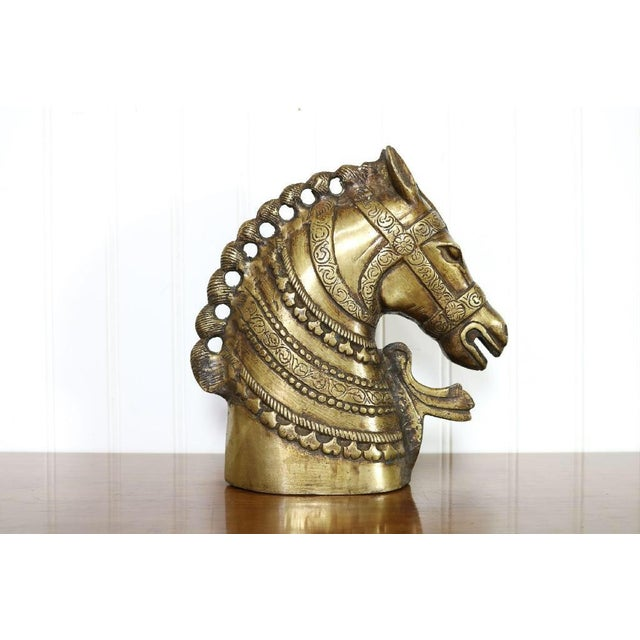 This beautiful brass horse head has beautiful details and an applied bronze finish throughout. It's a heavy piece weighing...