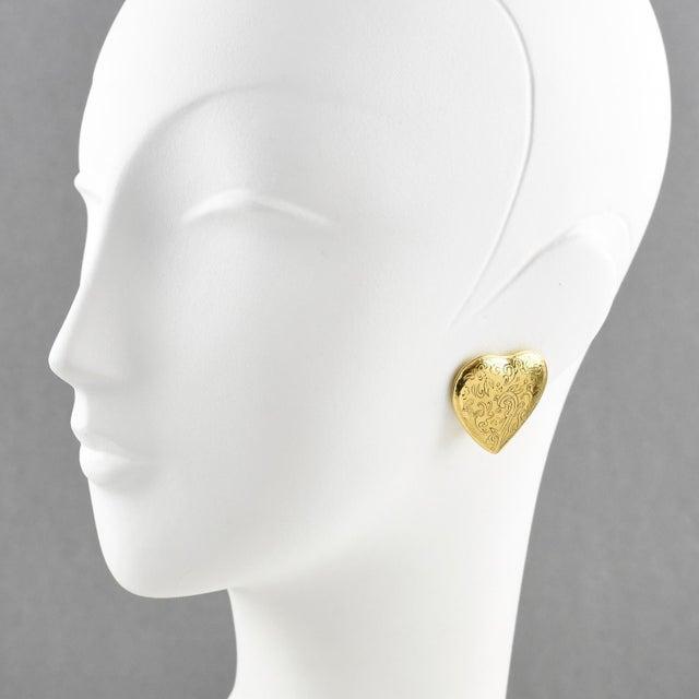 Lovely Yves Saint Laurent Paris signed clip on earrings. Romantic heart shape, shiny gilt metal ornate with black...