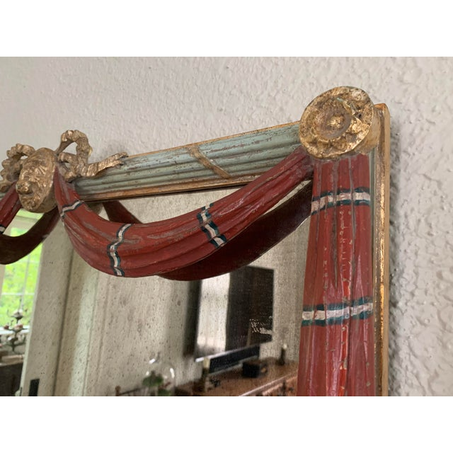 From Belgium, this wooden mirror has it all! Fantastic painted patina, mirror oxidation, and great color! This celadon...