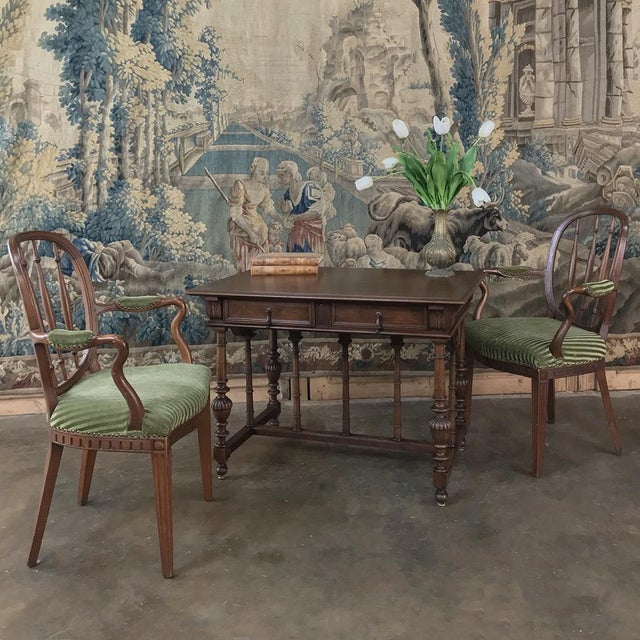 19th Century French Henri II Walnut Writing Table is a splendid example of the breed, with classical architecture enhanced...