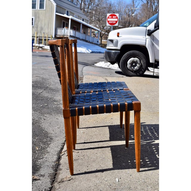 Pair of iconic Tomlinson woven leather dining chairs dated 1957, as seen in the paper tags attached. This is the rare...