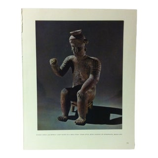 """Circa 1960 """"Pottery Effigy Jar - Showing a Man Seated on a Small Stool"""" Treasures of Ancient America Mounted Print For Sale"""